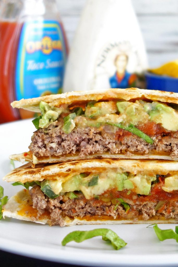 The quesadilla burger - topped with avocados, jalapenos, and cheese